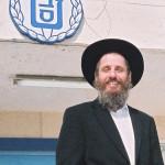 Rabbi Major (ret.) Fishel Jacobs at entrance to former prison.